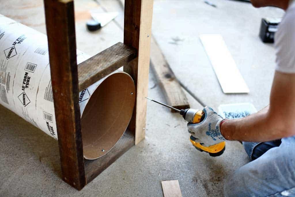 attaching front door slides of the DIY skunk trap