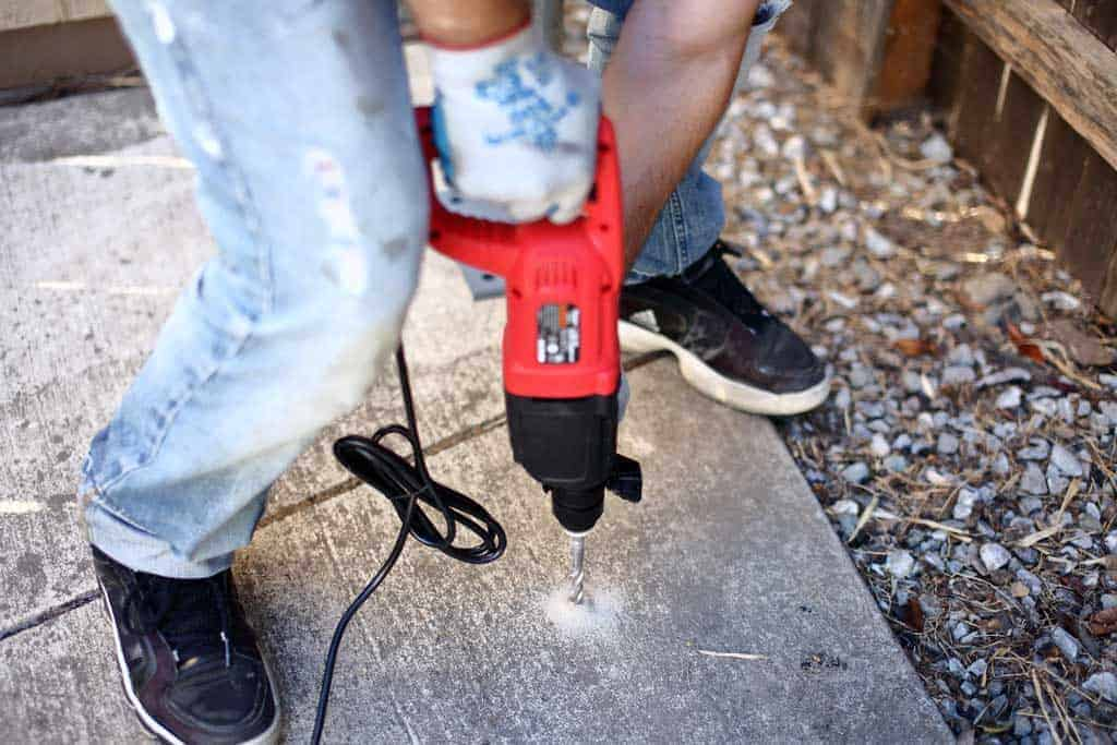 drilling a hole in the concrete