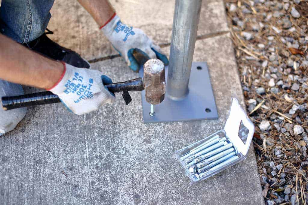 hammering anchors into the concrete