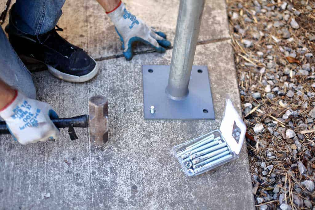 hammering anchor into the concrete