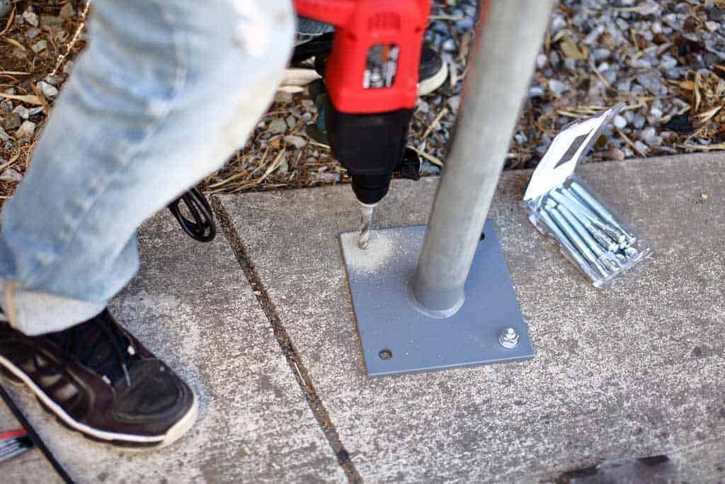 drilling concrete to insert anchors