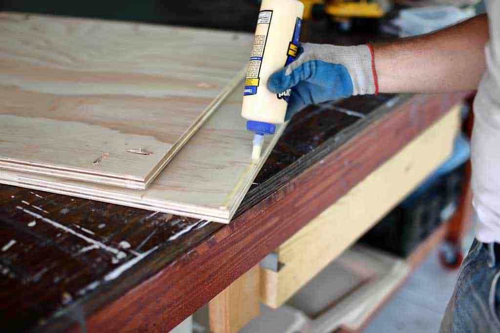 applying wood glue to the back board