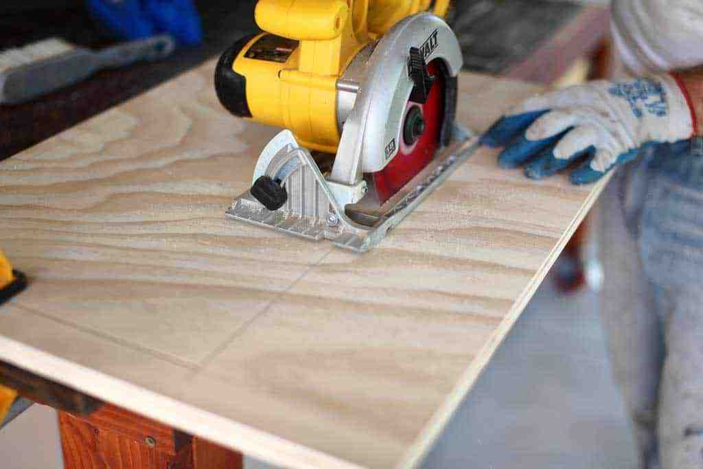 using skill saw to cut opening in the cabinet