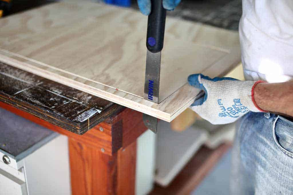 using dovetail saw to cut out opening for drawer