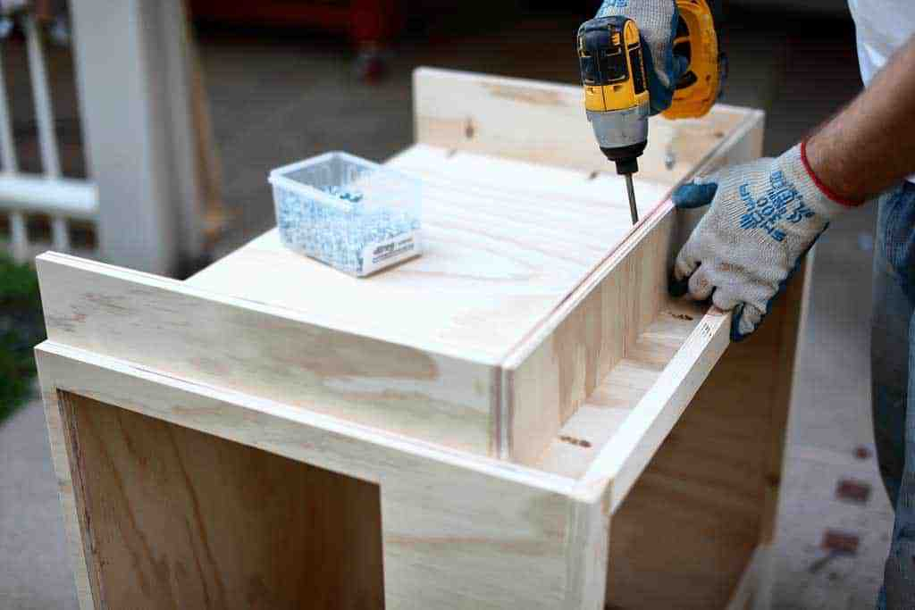 attaching base of the cabinet door
