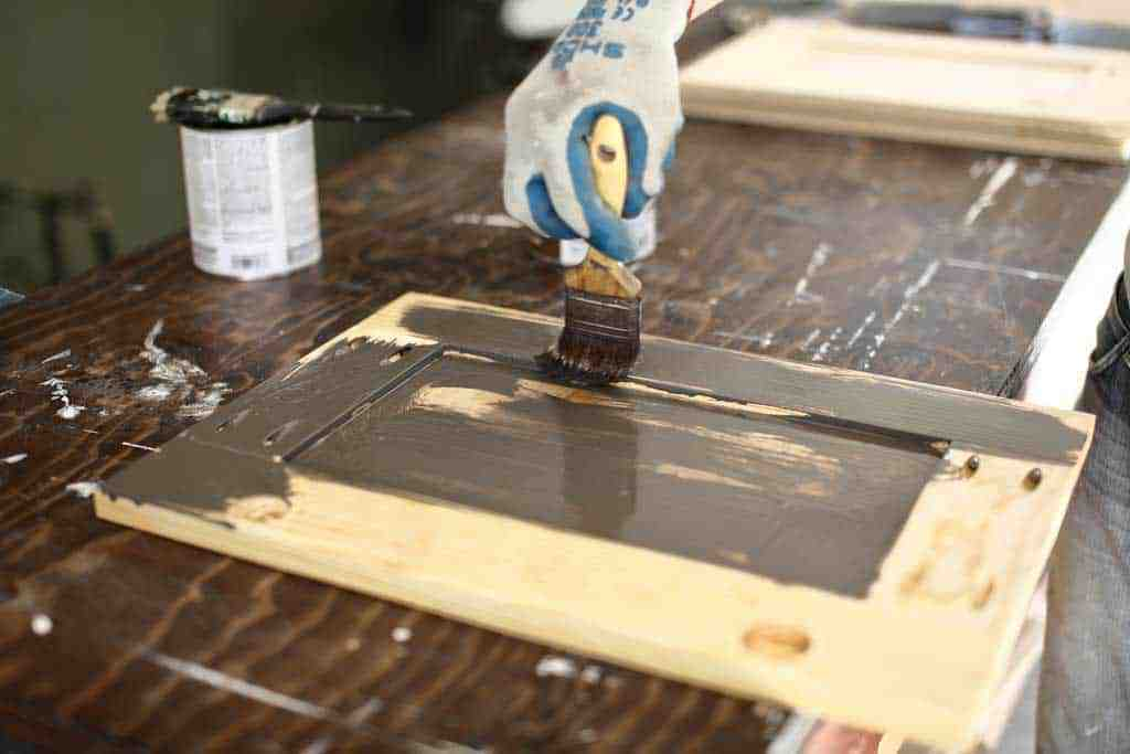 applying stain to the cabinet door