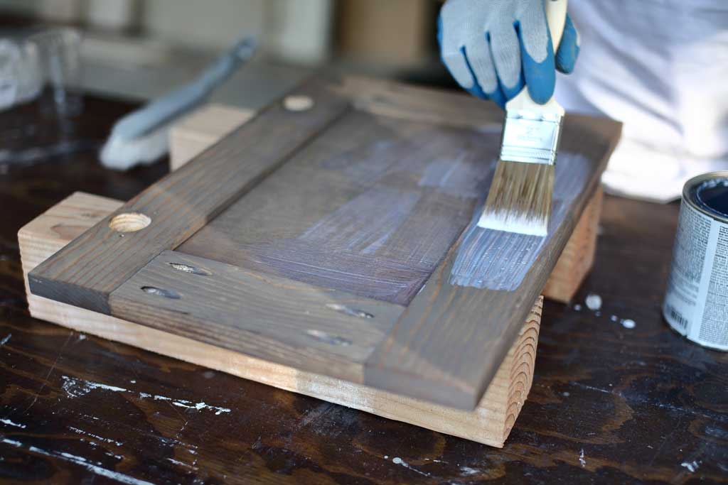 applying polyurethane to the cabinet door
