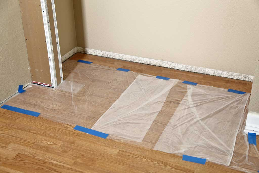 covering floor with plastic sheeting