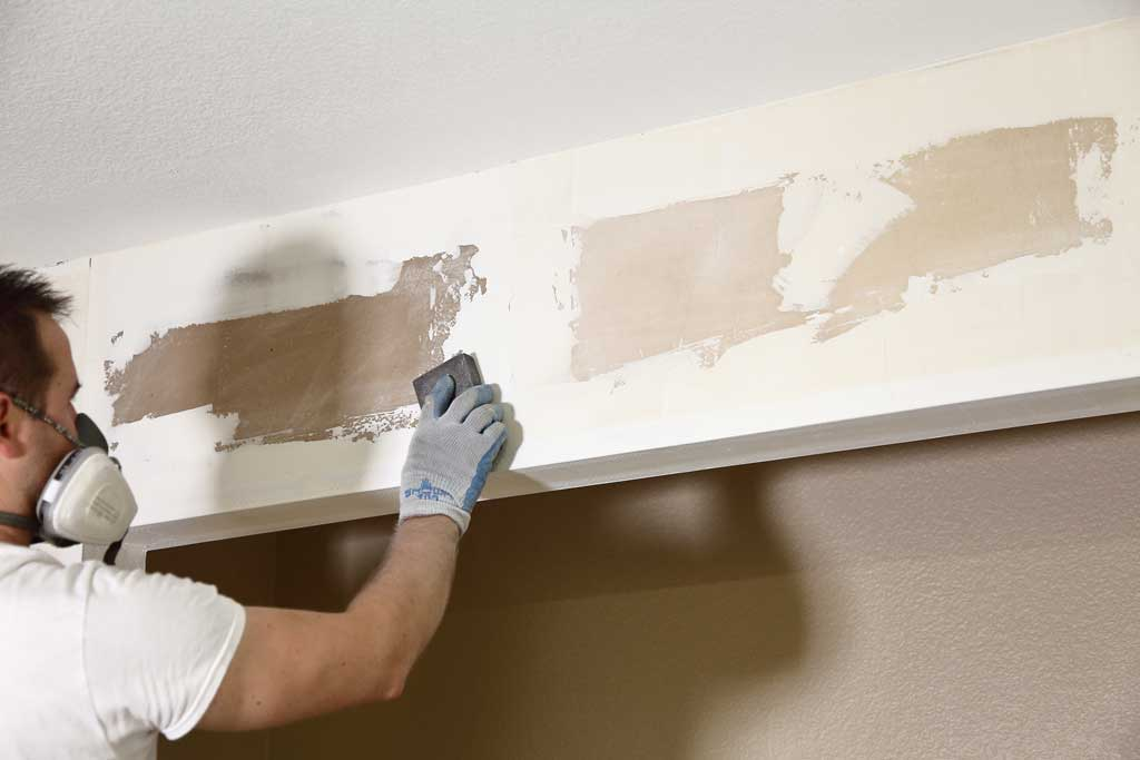 sanding drywall mud from wall