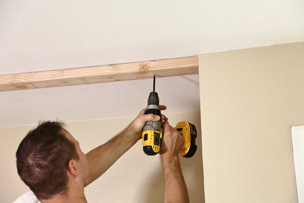 attaching top track to ceiling