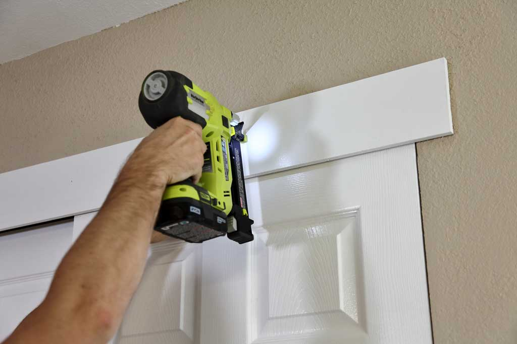 attaching decor board over the closet doors