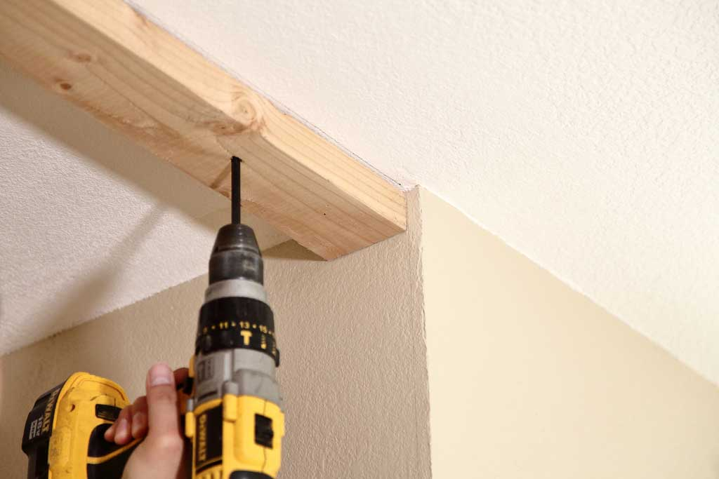 attaching top track to existing ceiling