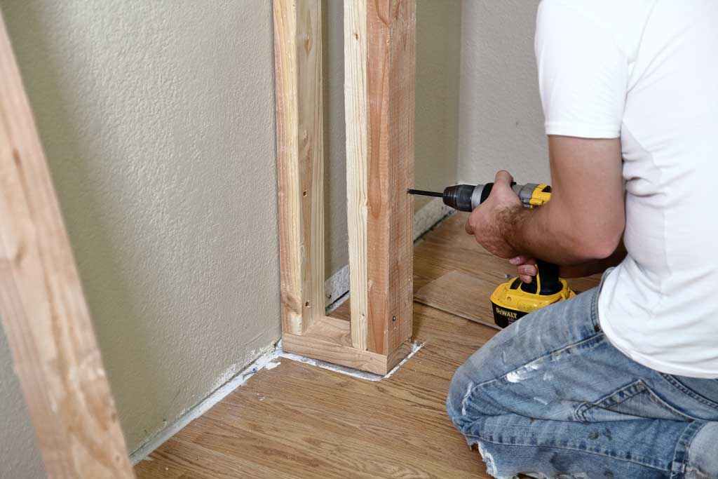 attaching trimmer stud to a wall of a diy closet