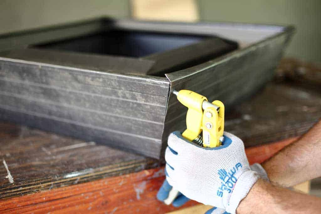 using pop rivet tool to join the corner of gutter