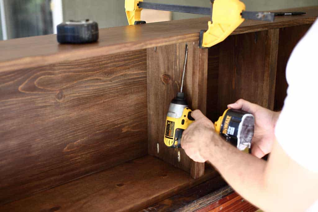 attaching shelf boards to the shelf frame