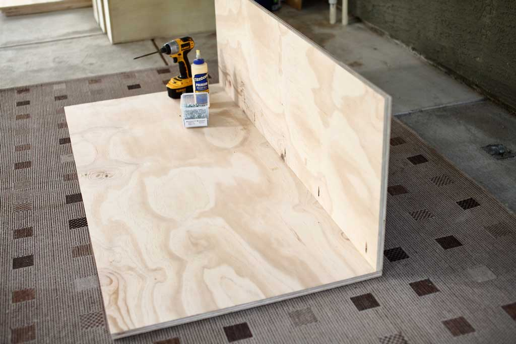 attaching side plywood to the backboard of the DIY closet organizer