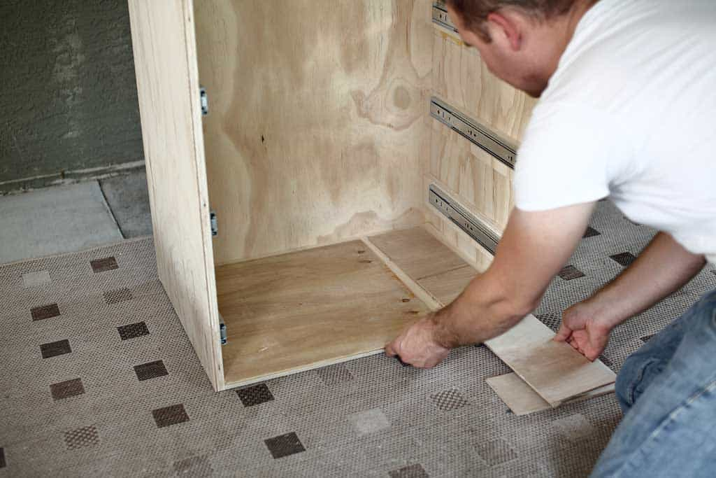 """using 1/4"""" plywood for spacer before attaching drawers"""