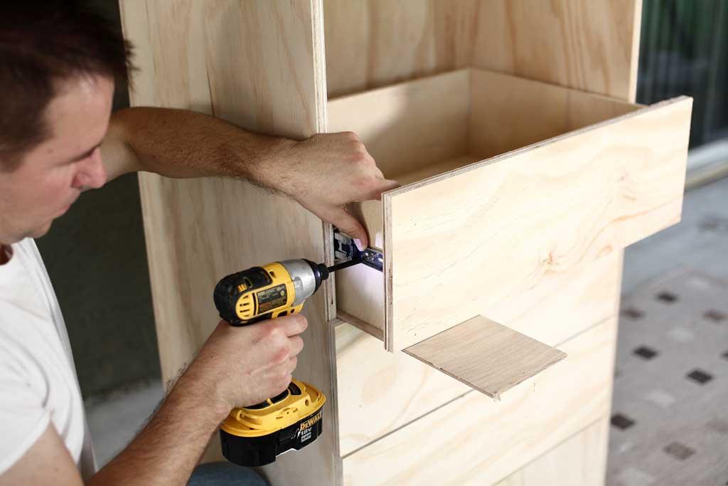 attaching drawers to the DIY closet organizer