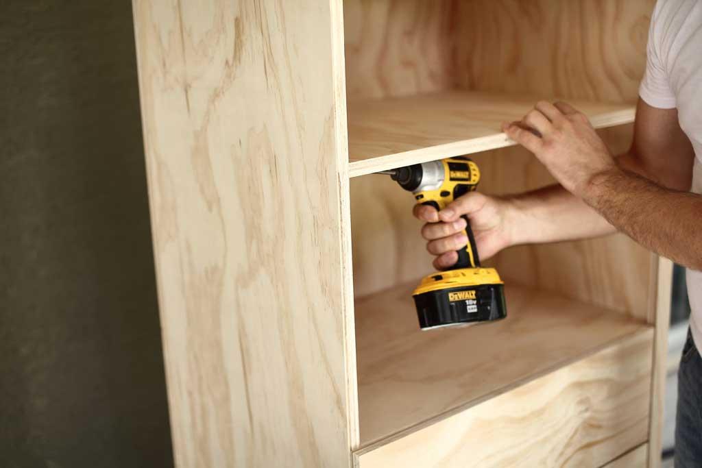 attaching shelves to the DIY closet organizer