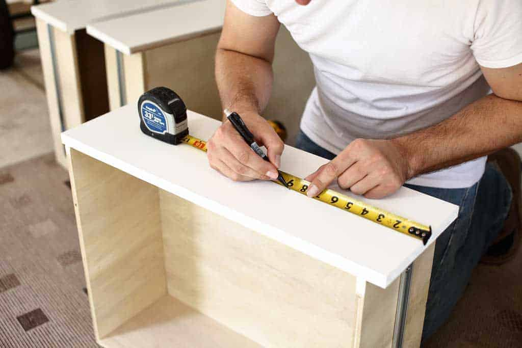 measuring where to drill holes for drawer handles