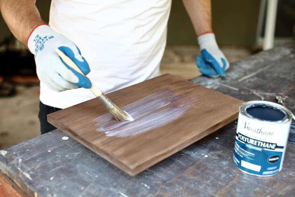 applying polyurethane on a board for diy jar organizer