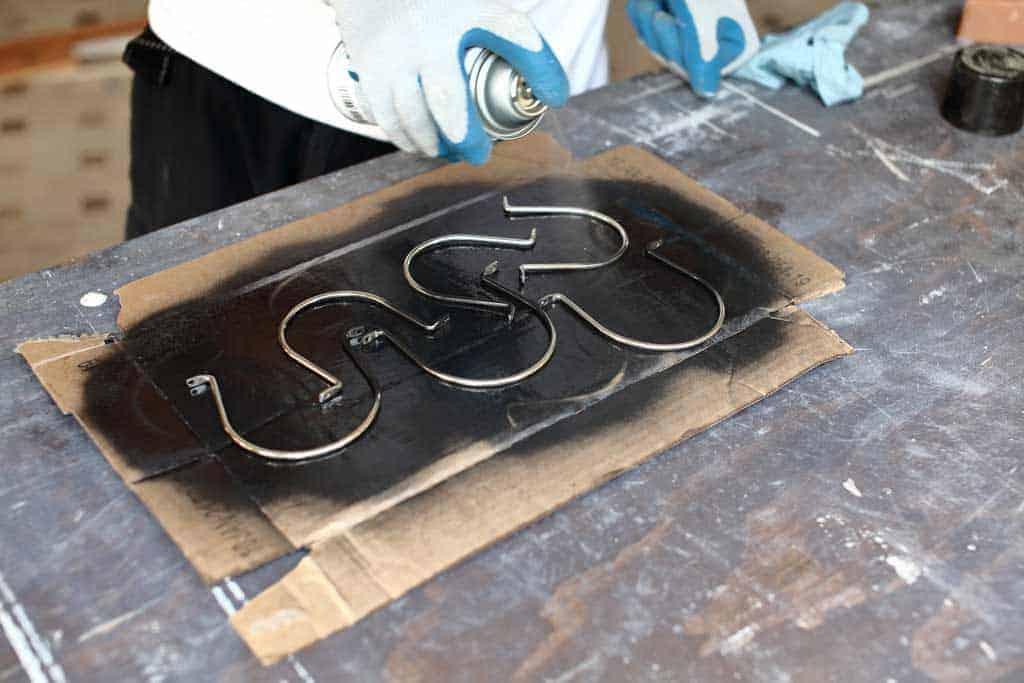 spray painting the jar straps