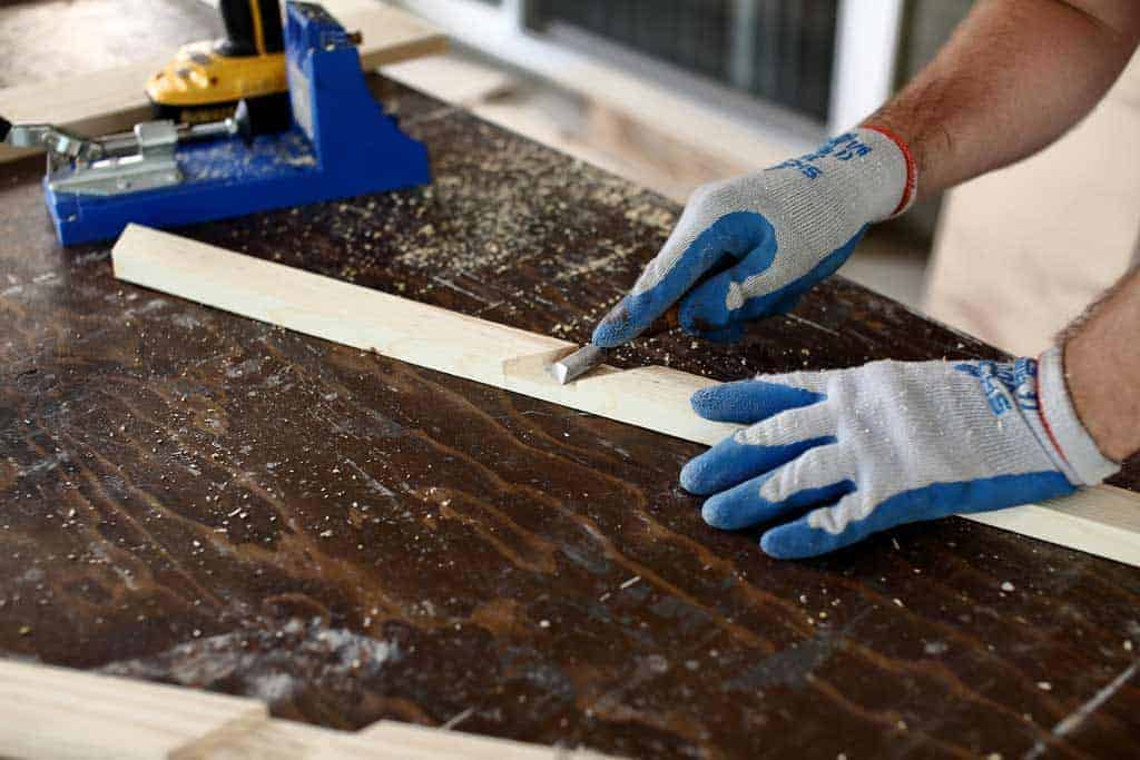 using wood chisel to remove dirt