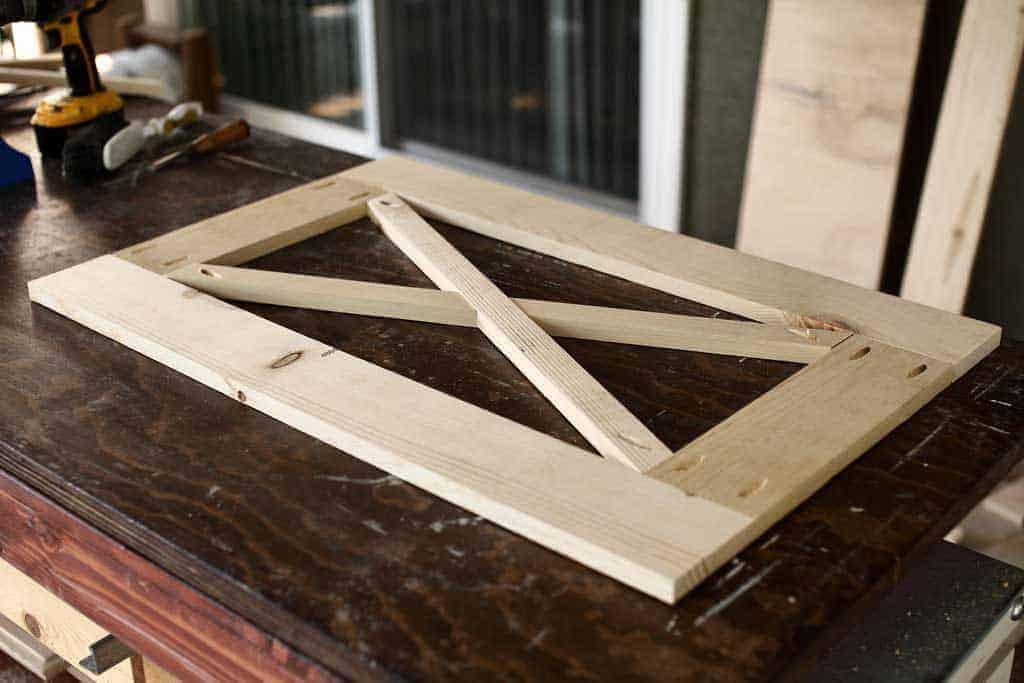 making a cross for farmhouse barn doors