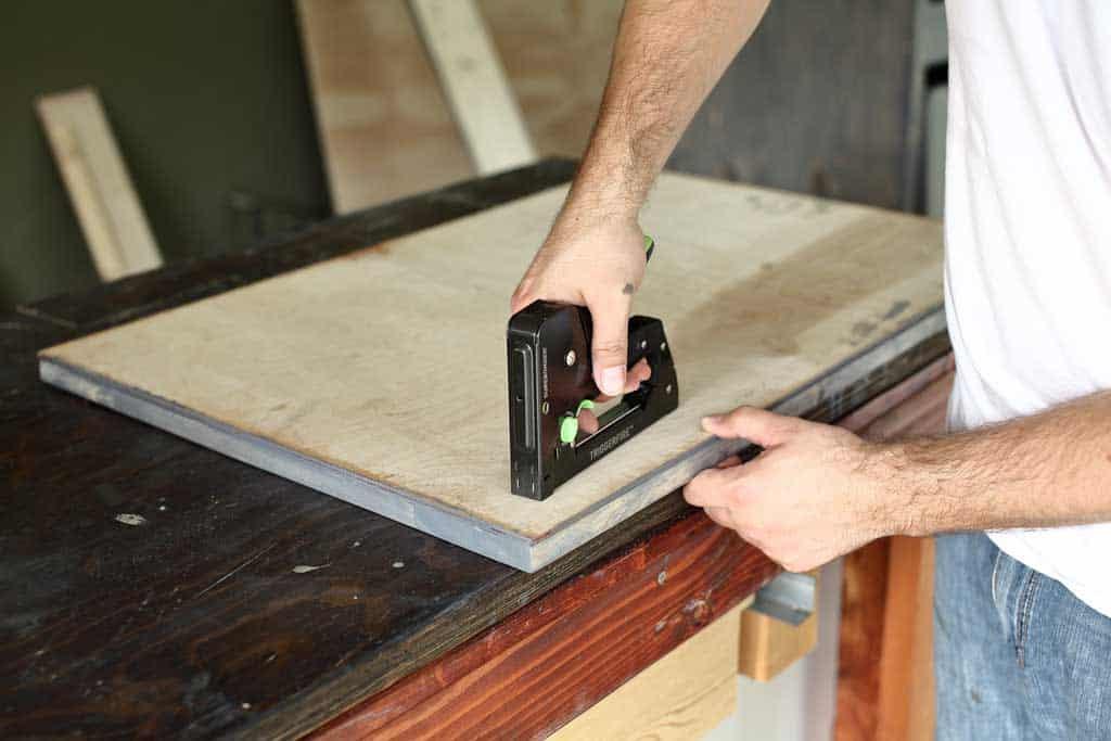stapling plywood to barn door