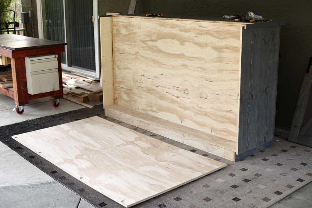 attaching backboard to the DIY Farmhouse Media Console with TV Lift