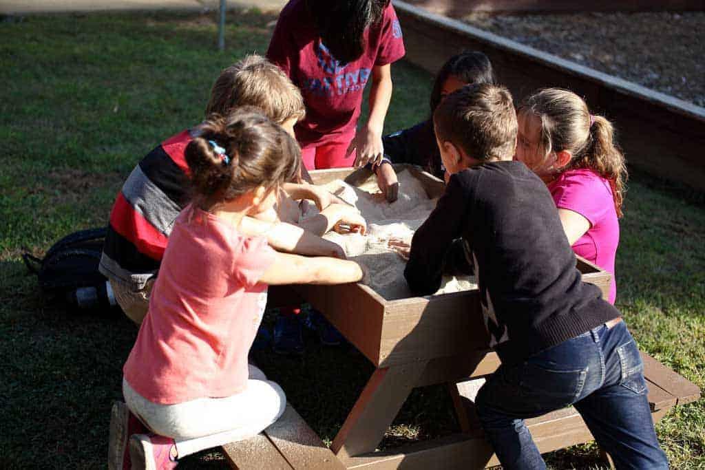 kids playing in DIY Sandbox