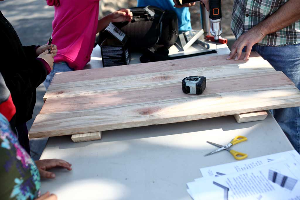 attaching the bottom boards for the sand box