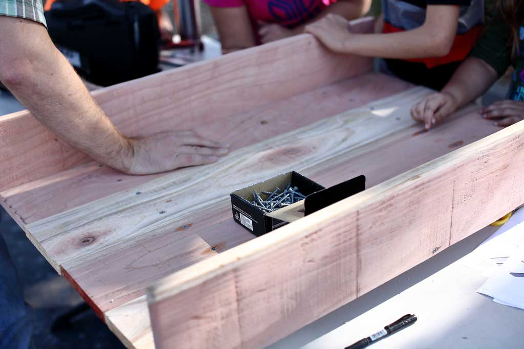 attaching side pieces for the diy sandbox