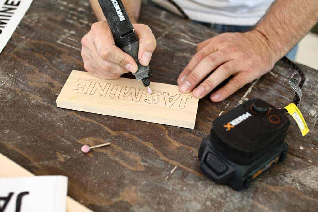 using makerx worx to carve letters on wood