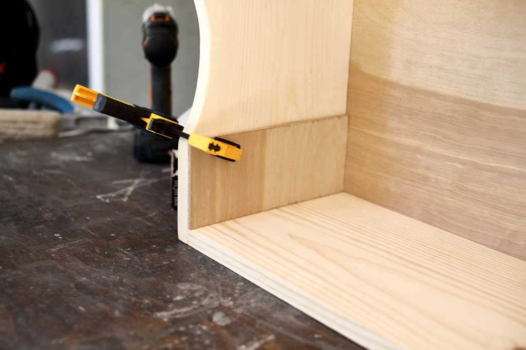 gluing the shelf supports