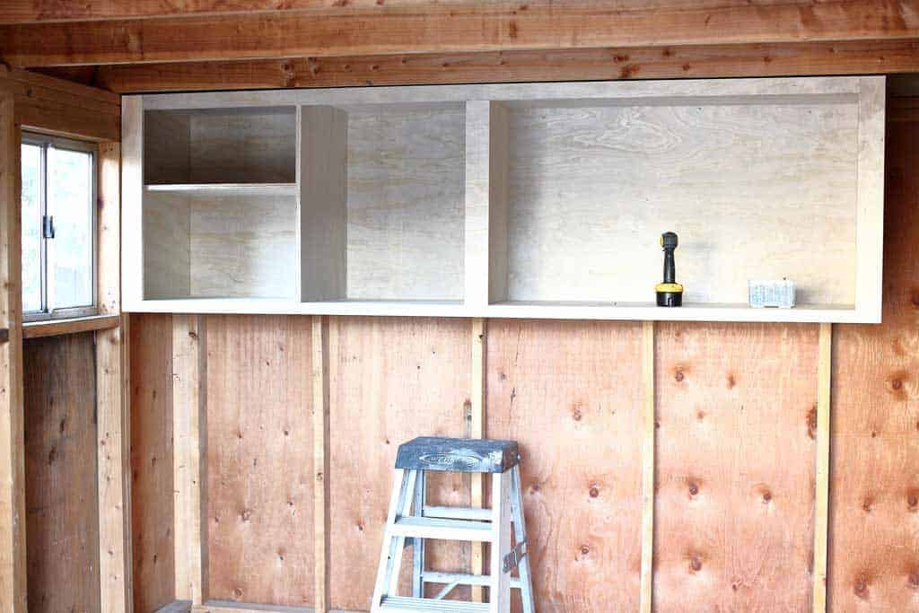 attaching cabinets inside the shed