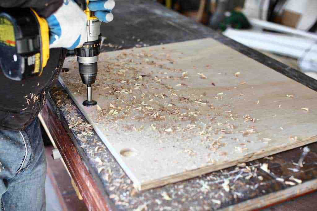 drilling holes for the hinges of cabinet doors