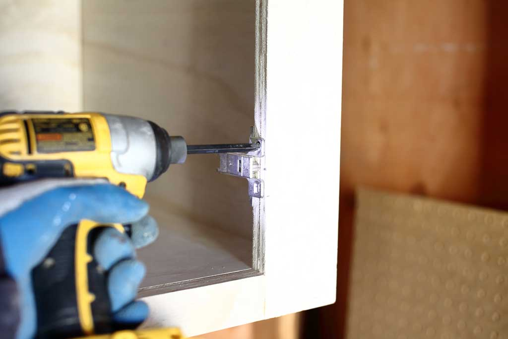 attaching door hinges to the face frame