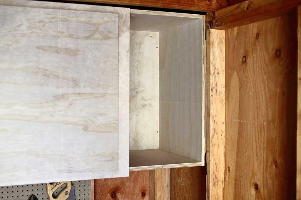 attaching shelf frame inside the shed