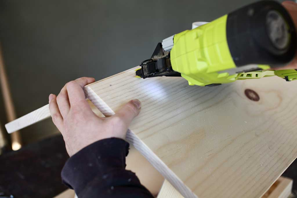 using nail gun to attach roof boards together
