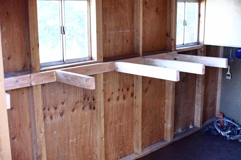 attaching shelf support to wall in a shed
