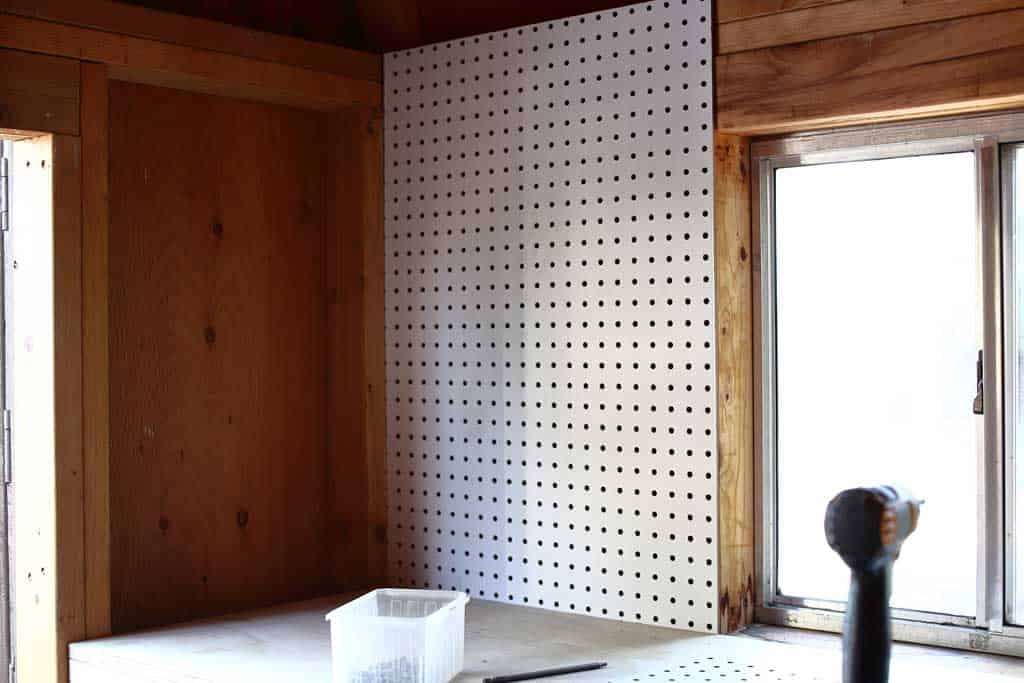 attaching pegboard to the wall