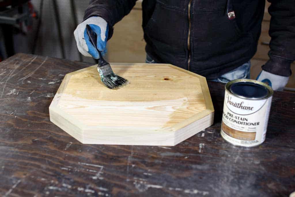 applying pre-stain to table top