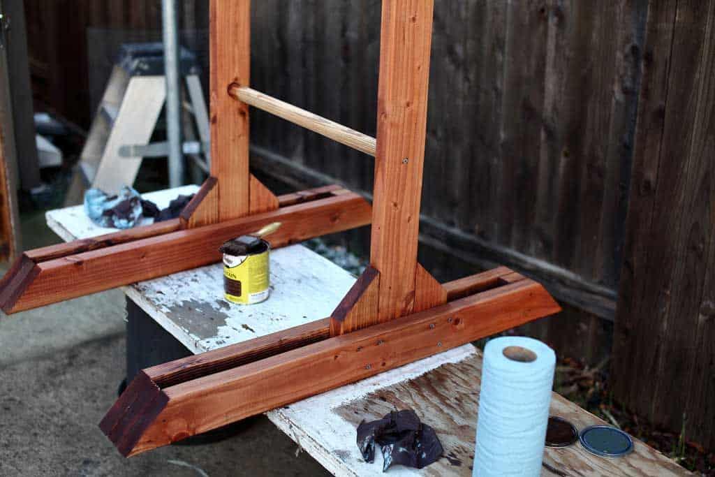 staining DIY wooden ladder toss game