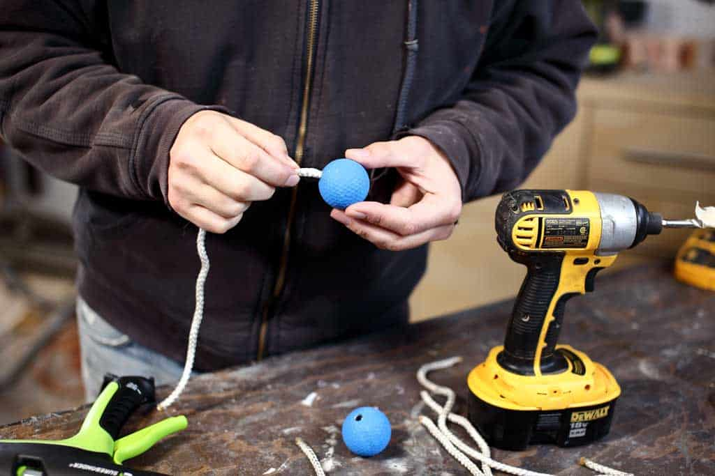 attaching rope to the golf ball