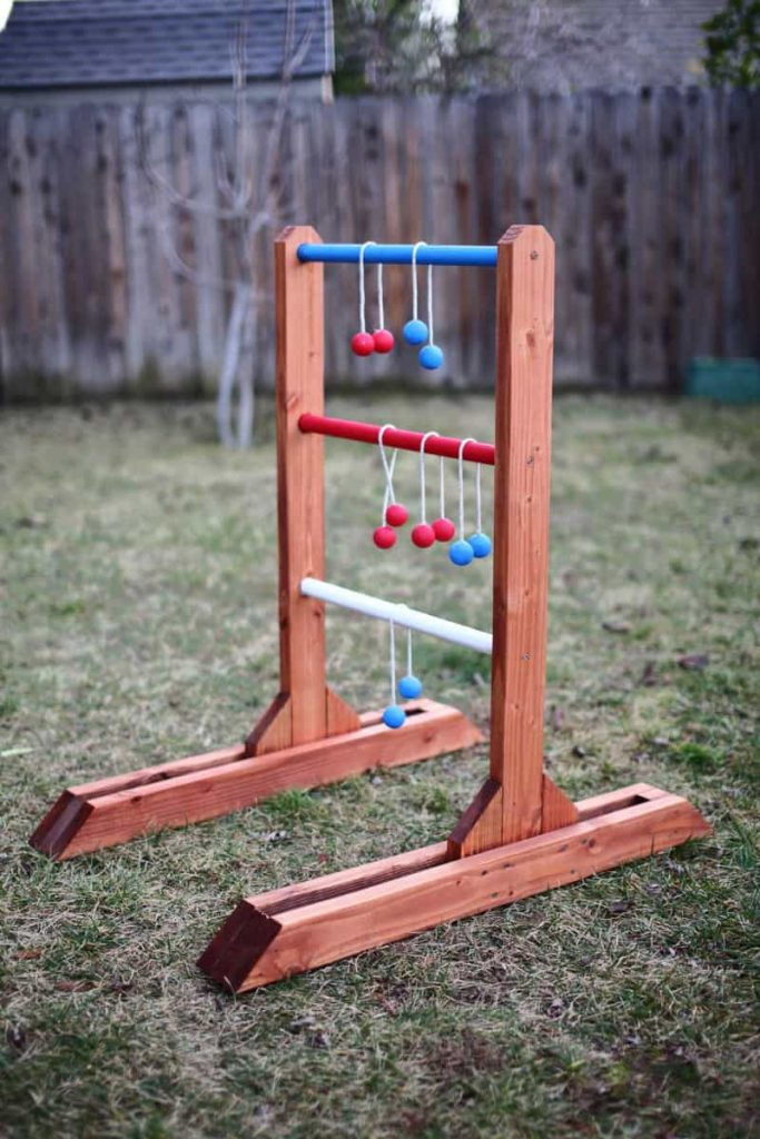 Now that you're done with the project, paint each dowel a different color for keeping the score easier. Then paint the rest of the ladder toss game with exterior paint to protect the wood. You're done with a DIY ladder toss game. Enjoy!