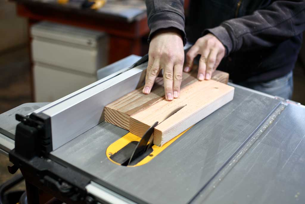 cutting legs using a jig on the table saw