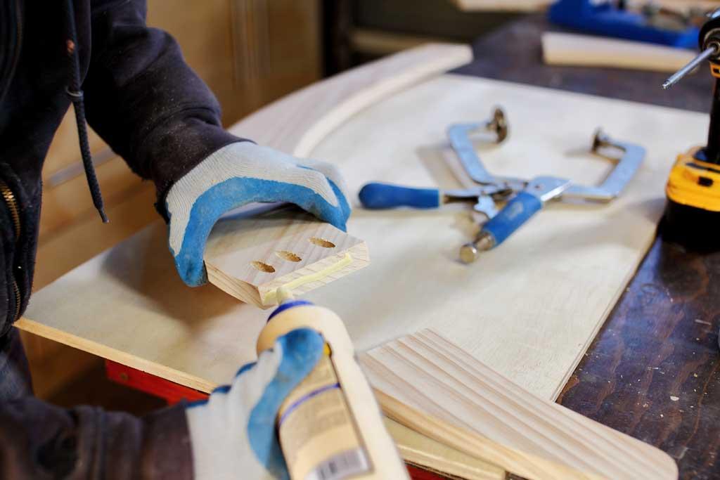 applying wood glue to rocker boards
