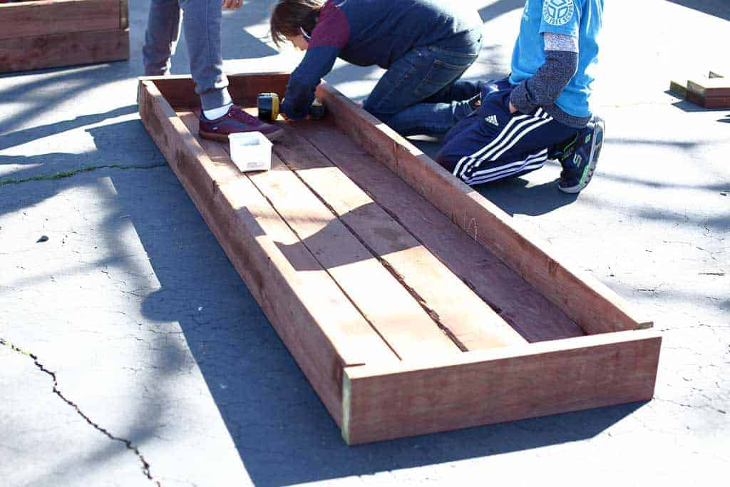 attaching lower section of the planter box