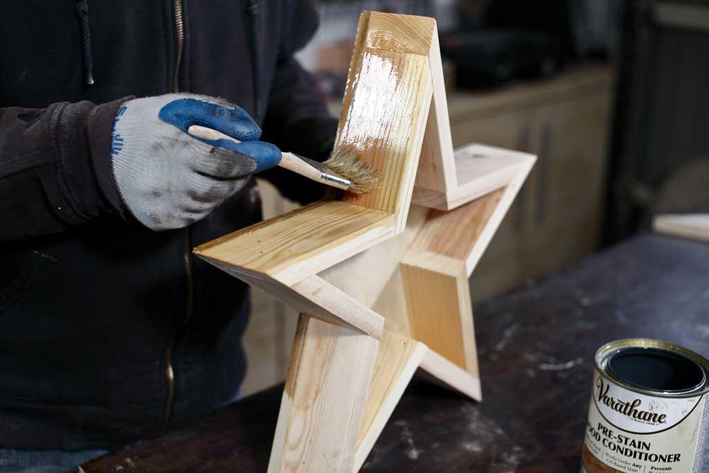applying pre-stain on star planter
